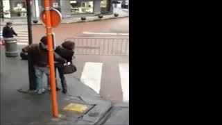 Drunk Girl in Boots and Heels is Unsuccessfully Stabilized by her Friend and Finally Falls