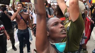 Protesters fill the streets of downtown Miami
