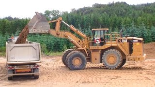 Cat 988H Wheelloader Loading Volvo Trucks