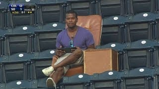Fan Lounges In Leather Chair At Petco Park