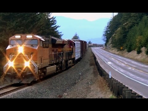 BNSF & KANSAS CITY SOUTHERN duo power a freight train up the Columbia river gorge