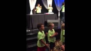 Kids worshipping with their parents/families