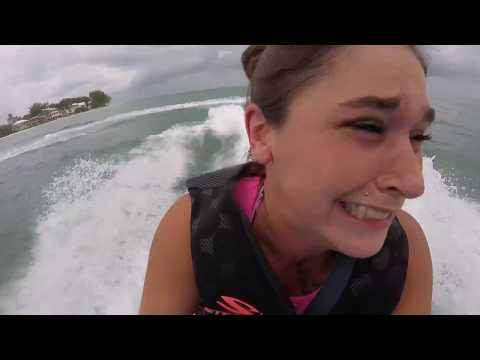 Mom crying on back of jet ski with son driving