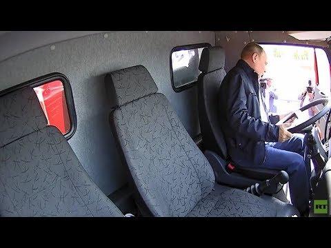 Putin drives Kamaz truck across newly opened Crimean bridge