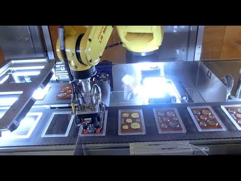 Robotic Coin Set Assembly System Uses 13 FANUC Robots to Assemble Coin Sets - Farason Corporation
