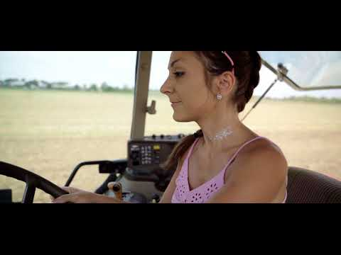 Farmer girl with the big traktor