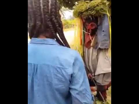 Nigerian lady coverts masquerader to Christianity, makes him remove his masquerade costume
