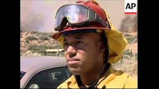 Wildfires destroy homes, hundreds ordered to evacuate