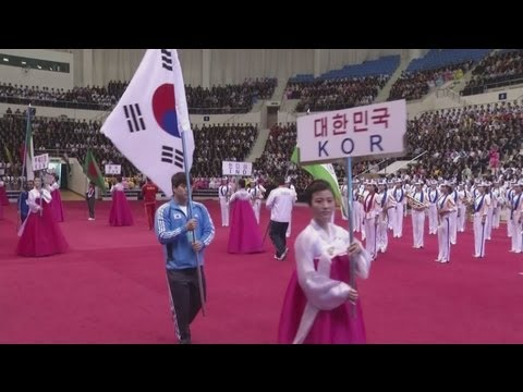 North and South Korea take part in historic opening ceremony