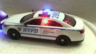 NYPD 1/24 scale diecast model car with working lights and siren