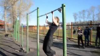 the girl is engaged on a horizontal bar