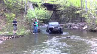 Jeep goin through creek