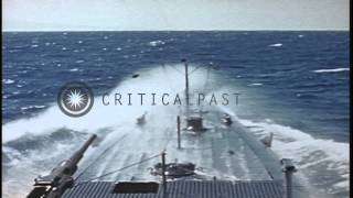 Signalman operating blinker light and other men aboard USS Sea Owl underway in th...HD Stock Footage
