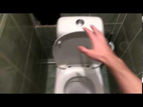 Как опустить крышку унитаза