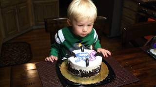 2 year old trying to blow out candle on birthday cake