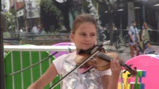 A Girl playing Despacito from Santa Monica
