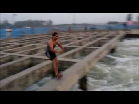 11 Boys diving in the Ganga canal India