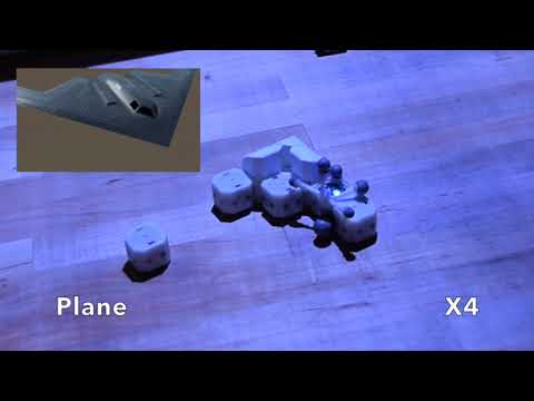 Robotic Assembly of Haptic Proxy Objects for Tangible