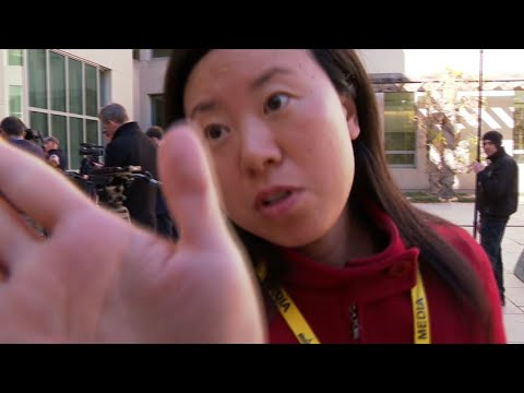 Bizarre stand-off with Chinese journalist caught on camera in Canberra