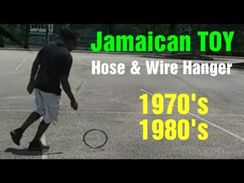Jamaican TOY, how to make a Hose hoop wheel with a Clothes-hanger wire guide   red bwoy tv 🔴