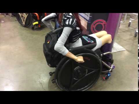 Angela Rockwood (C4-C5 quadriplegic) trying out rowheels at the LA abilities Expo.