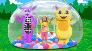 Sasha and Dima play outdoor games and have fun with the giant bubble