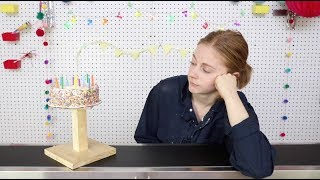 Eating birthday cake off a conveyor belt