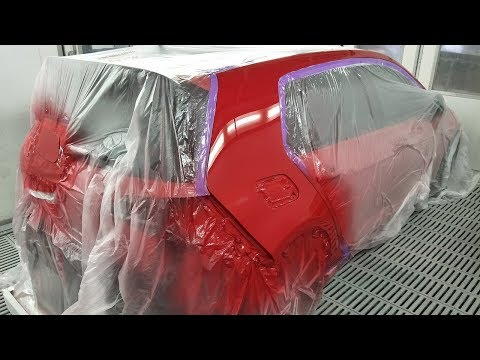 Red VW Golf Spray Painting