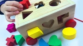 Play & Learn SHAPES with cute colorful wooden multifunctional intelligence box. Early education toy.