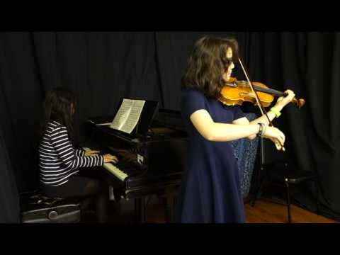 Raina playing Bach violin concerto No. 2 in E Major with me accompanying on piano
