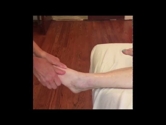 Massaging the left foot and calf post-traumatic injury