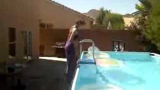 girl jumping in a pool with her p jays