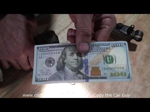 How To Spot A Fake 100 Dollar Bill