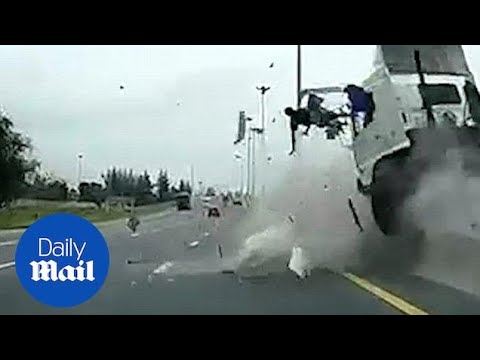 Terrifying moment truck driver hurled through the air in crash