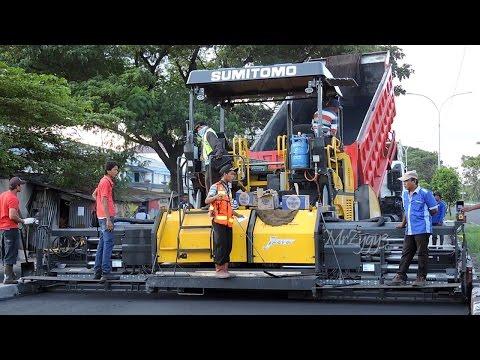 Asphalt Paver Sumitomo HA90C And Dump Truck Working