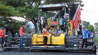 Asphalt Paver Sumitomo HA90C And Dump Truck Working