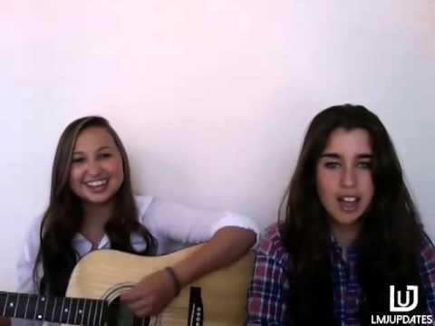 Lauren Jauregui singing with a friend