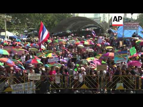 Protesters arrive in Bangkok ahead of Monday's planned demonstrations and roadblocks