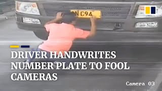 Driver in China handwrites number plate to fool surveillance cameras