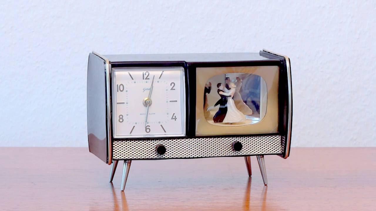 Design Tischuhr tischuhr wecker mit tanzpaar spiel goldbühl 1950er