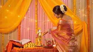 Indian woman offering flowers to Lord Krishna during festivities - Janmashtami Celebration