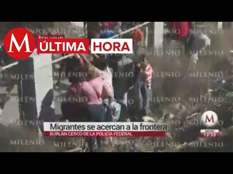 ÚLTIMA HORA: migrantes rompen cerco policíaco y corren a frontera con USA