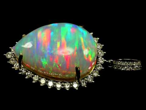 20 ct Ethiopian Welo Opal Pendant (in white gold and diamond setting)