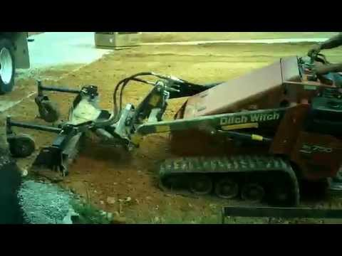 Harley Rake on Ditch Witch SK750 Mini Skid Steer