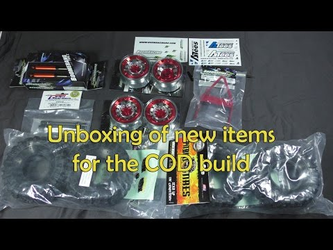 Unboxing PitBull tires, Boomracing wheels, bumper, driveshaft