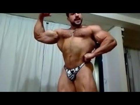 Huge hairy bodybuilder flexing