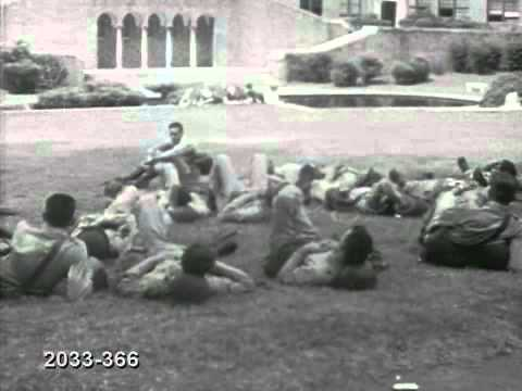 1957 National Guard troops relax on lawn of Central High Schooll  Little Rock, Arkansas