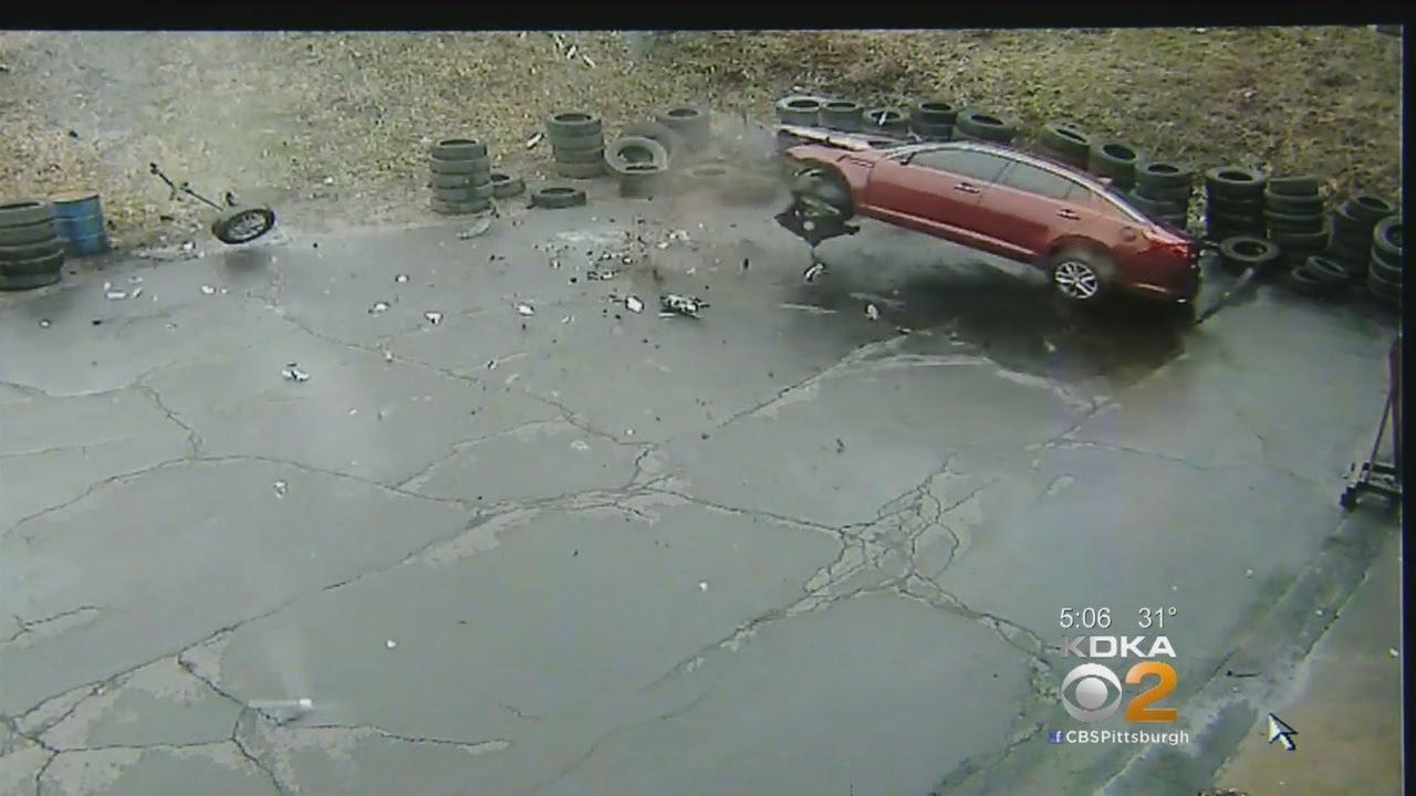 Video: Car Flies Off Parkway West, Crashes Into Auto Shop