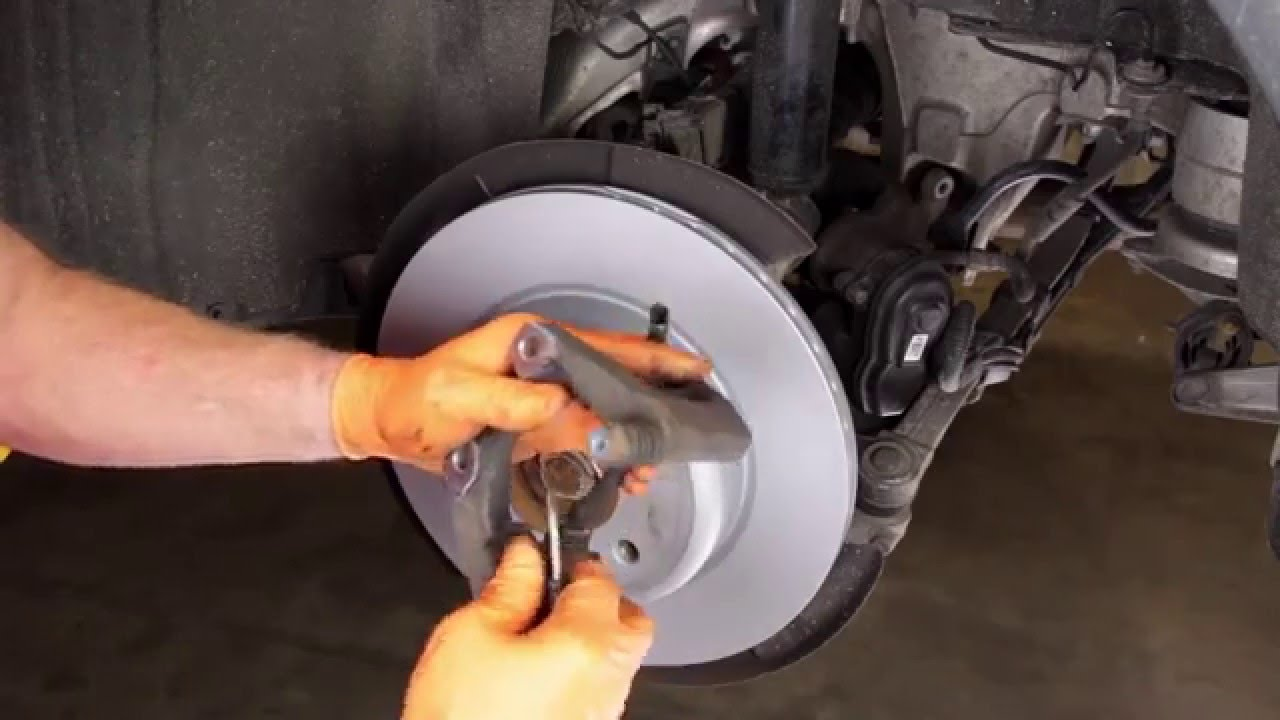 Replacing Rear Brake Pads And Rotors On Bmws With Electric
