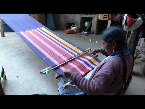 Weaving a scarf in the ancient technique of discontinuous warp.